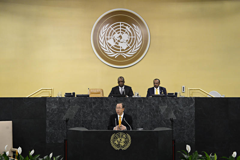 President of the 68th Session of the United Nations General Assembly John Ashe, left, and U.N. Under Secretary-General Tegegnework Gettu, right, are seated above listening as U.N. Secretary General Ban Ki-moon speaks during the 68th United Nations General Assembly on Tuesday Sept. 24, 2013 in New York. (AP Photo/Andrew Burton,Pool)