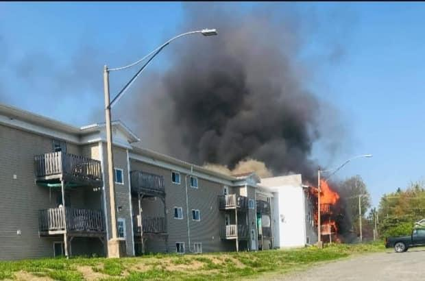 Fredericton Fire Department crews were called to a fire at an apartment building on Gilbert Street on Thursday. (Submitted by Kayla Robertson - image credit)