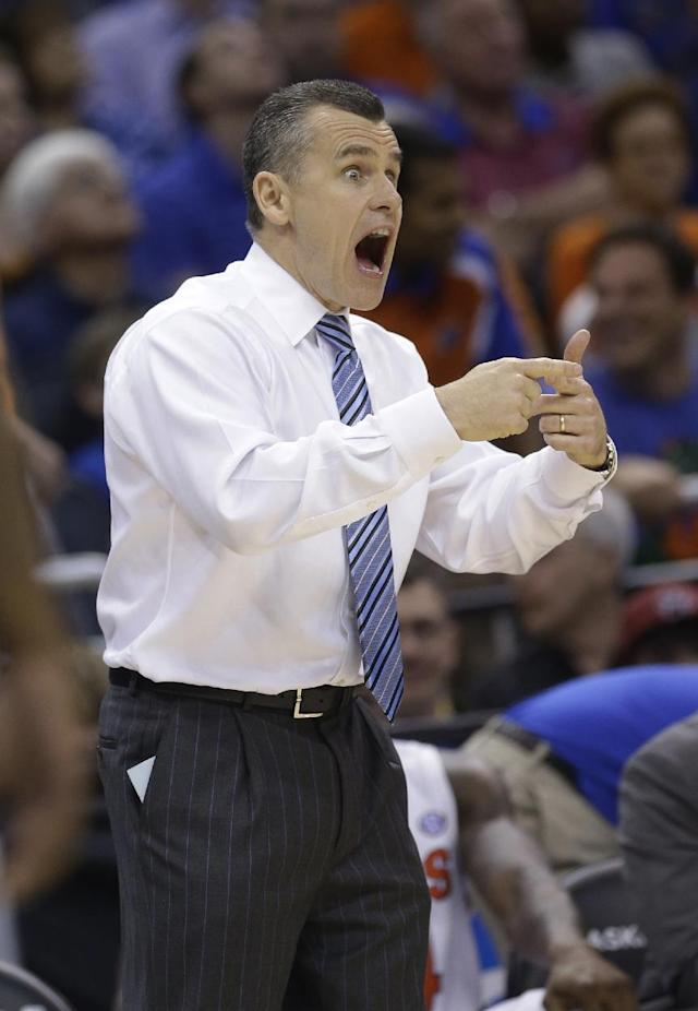 Florida coach Billy Donovan gestures during the second half in a third-round game in the NCAA college basketball tournament against Pittsburgh, Saturday, March 22, 2014, in Orlando, Fla. (AP Photo/John Raoux)