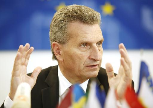 EU-Commissioner for Energy German Guenther Oettinger gestures during a press conference, concerning the troubles about gas between Russia and the Ukraine on June 16, 2014 in Vienna