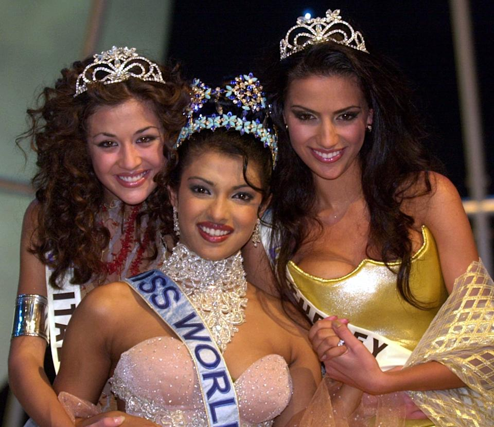 Miss India, Priyanka Chopra, 18, the new Miss World, centre, poses with runner up Miss Italy Giorgia Palmas, 18, left, and Miss Turkey Yuksel Ak, 20, at London's Millennium Dome Thursday, November 30, 2000. (AP Photo/Adam Butler)
