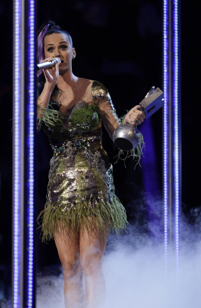 """Katy Perry reacts after winning Best Video for """"California Gurls"""" at the MTV European Music Awards 2010, in Madrid, Sunday, Nov. 7, 2010. (AP Photo/Joel Ryan)"""