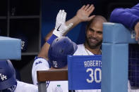 Los Angeles Dodgers' Will Smith, left, is congratulated by Albert Pujols after hitting a solo home run during the second inning of a baseball game against the Arizona Diamondbacks Monday, May 17, 2021, in Los Angeles. (AP Photo/Mark J. Terrill)