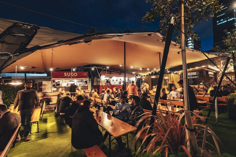 "<p>This vast outdoor space of <a href=""https://www.vinegaryard.london/"" rel=""nofollow noopener"" target=""_blank"" data-ylk=""slk:Vinegar Yard"" class=""link rapid-noclick-resp"">Vinegar Yard</a> has canopy covers for the rain so that you and five friends (max) can enjoy street food from vendors like Baba G's and Nanny Bill's while staying warm drinking homemade mulled wine and hot apple cider. </p>"
