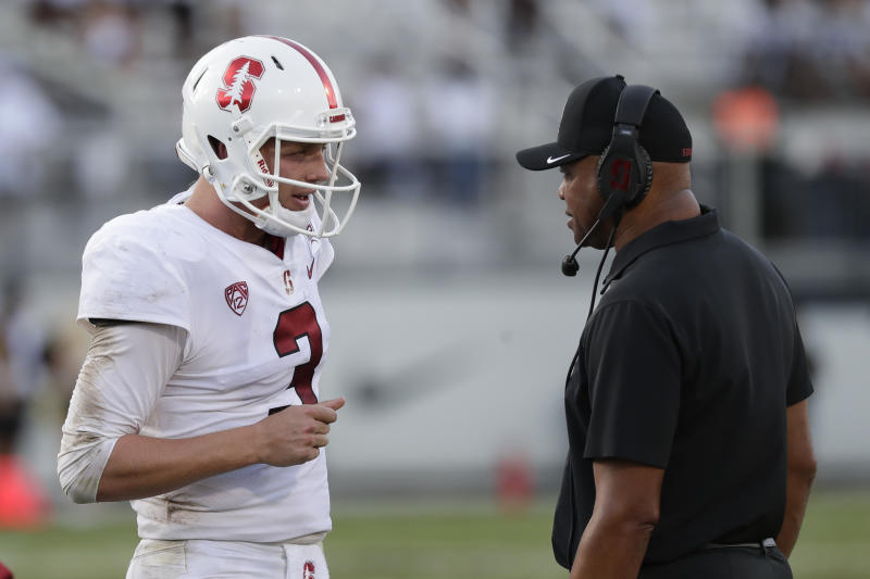 Stanford quarterback K.J. Costello, left, talks with head coach David Shaw during a time out in the second half of an NCAA college football game against Central Florida, Saturday, Sept. 14, 2019, in Orlando, Fla. (AP Photo/John Raoux)