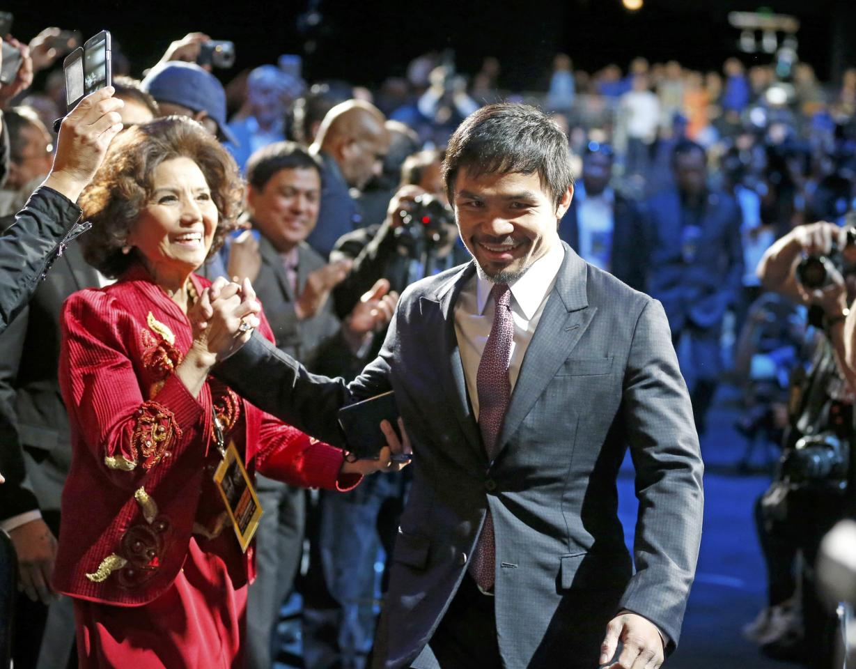"Eight-division world boxing champion Manny ""Pac-Man"" Pacquiao arrives for a press conference with eleven-time, five-division world champion Floyd ""Money"" Mayweather  in Los Angeles, California March 11, 2015.   REUTERS/Lucy Nicholson (UNITED STATES  - Tags: SPORT BOXING PROFILE ENTERTAINMENT)"