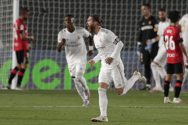 Real Madrid's Sergio Ramos celebrates after scoring his side's second goal during the Spanish La Liga soccer match between Real Madrid and Mallorca at Alfredo di Stefano stadium in Madrid, Spain, Wednesday, June 24, 2020. (AP Photo/Bernat Armangue)