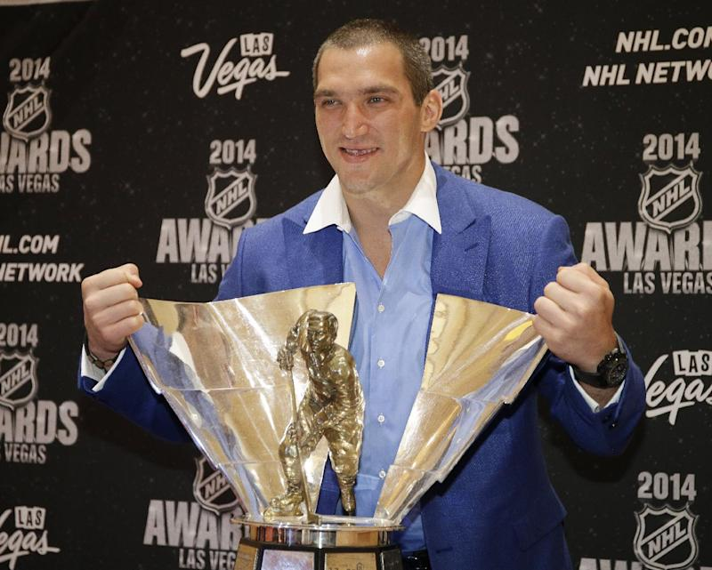 Alex Ovechkin of the Washington Capitals poses with the Richard Trophy after winning the award for top goal-scorer, at the NHL Awards on Tuesday, June 24, 2014, in Las Vegas