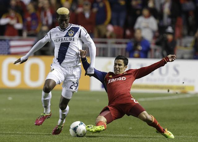 Real Salt Lake defender Tony Beltran (2) defends against Los Angeles Galaxy's Gyasi Zardes (29) in the first half during the second leg of the MLS Western Conference semifinal soccer game, Thursday, Nov. 7, 2013, in Sandy, Utah. (AP Photo/Rick Bowmer)