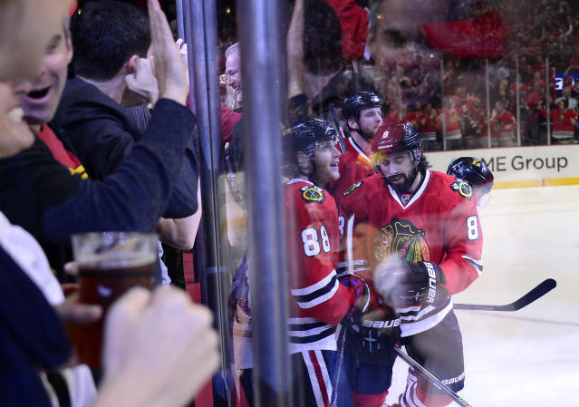 Fans pound on the glass as Blackhawks Nick Leddy delivers the first goal of the game during Game 2 of the Western Conference finals in the NHL hockey Stanley Cup playoffs Wednesday, May 21, 2014, in Chicago. The Kings won 6-2. (AP Photo/Daily Herald, Mark Welsh)