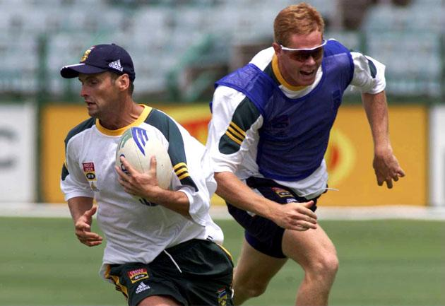 24 Nov 1999:  Gary Kirsten of South Africa plays rugby with team-mate Shaun Pollock during net practice at the Wanderers Cricket ground in Johannesburg, South Africa. Mandatory Credit: Laurence Griffiths/ALLSPORT