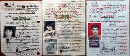 Handout of citizenship identification cards issued by Iraqi government showing Abeer Qasim Hamza al-Janabi and her parents