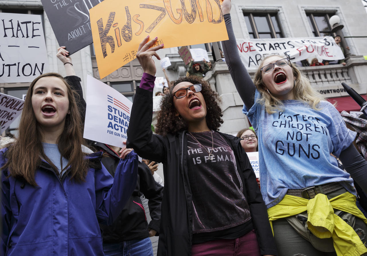 """<p>Baylor School student Avery Santin, left, and East Hamilton High School students Haylee Duncan, center, and Lauren Gossett chant on the steps of the Hamilton County Courthouse during a """"March for Our Lives"""" rally on Saturday, March 24, 2018, in Chattanooga, Tennessee. (Doug Strickland/Chattanooga Times Free Press via AP) </p>"""