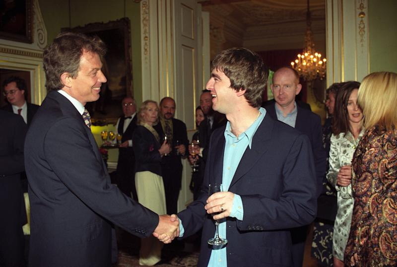 Prime Minister Tony Blair (left) meets Oasis star Noel Gallagher at a reception held at 10 Downing Street. (Photo by Rebecca Naden - PA Images/PA Images via Getty Images)