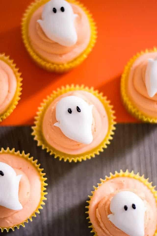 """<p>Get the <a href=""""https://www.cookiedoughandovenmitt.com/ghost-cupcakes/"""" rel=""""nofollow noopener"""" target=""""_blank"""" data-ylk=""""slk:Ghost Cupcakes"""" class=""""link rapid-noclick-resp"""">Ghost Cupcakes</a> recipe. </p><p>Recipe from <a href=""""https://www.cookiedoughandovenmitt.com/"""" rel=""""nofollow noopener"""" target=""""_blank"""" data-ylk=""""slk:Cookie Dough and Oven Mitt"""" class=""""link rapid-noclick-resp"""">Cookie Dough and Oven Mitt</a>.</p>"""