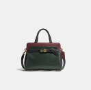 """<p><strong>Coach</strong></p><p>coach.com</p><p><a href=""""https://go.redirectingat.com?id=74968X1596630&url=https%3A%2F%2Fwww.coach.com%2Fproducts%2Ftate-carryall-29-in-colorblock%2FC5316.html%3Ffrp%3DC5316%2BB4SZG&sref=https%3A%2F%2Fwww.elle.com%2Ffashion%2Fshopping%2Fg37779639%2Fcoach-sale-bags-2021%2F"""" rel=""""nofollow noopener"""" target=""""_blank"""" data-ylk=""""slk:Shop Now"""" class=""""link rapid-noclick-resp"""">Shop Now</a></p><p><strong><del>$595</del> $446.25 (20% off with code SAVENOW)</strong></p><p>Colorblocking isn't just for clothing. This leather satchel is a lesson in mixing fall tones. With three interior compartments, it's also spacious enough to carry all your everyday essentials.<br></p>"""