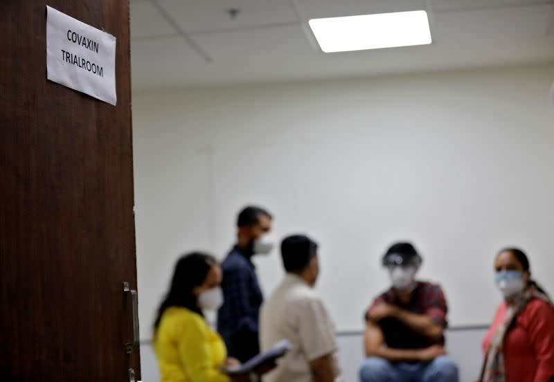 FILE PHOTO: Medics prepare to administer COVAXIN, an Indian government-backed experimental COVID-19 vaccine, to a health worker during its trials, in Ahmedabad