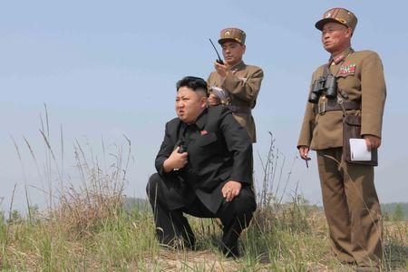 FILE PHOTO: North Korean leader Kim Jong Un guides the multiple-rocket launching drill of women's sub-units under KPA Unit 851