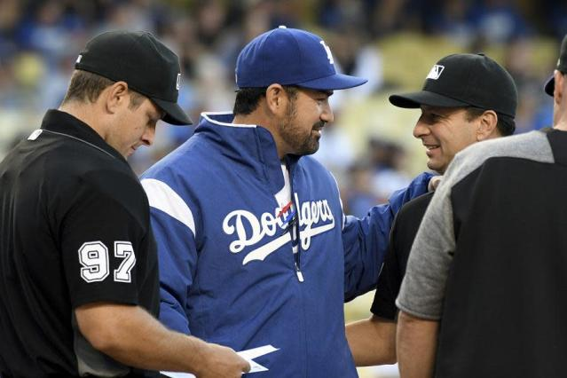 Veteran first baseman Adrian Gonzalez has been mostly absent during the postseason, but returned to Dodger Stadium for Game 2 of the World Series. (AP)