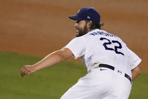 Kershaw hits strikeout marks, sends Dodgers past D-Backs 5-1