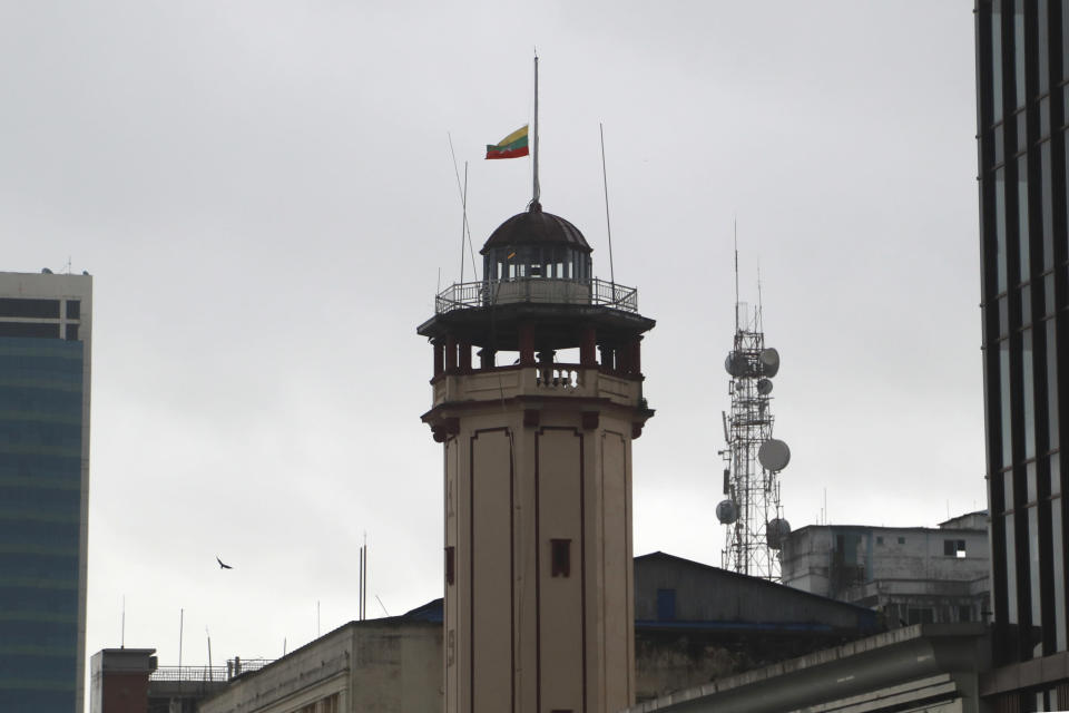 The Myanmar flag is flown at half-staff over the Myanmar Fire Services Department building in observance of Martyrs' Day in Yangon, Myanmar Monday, July 19, 2021. Myanmar's military-installed government and those seeking to topple it on Monday marked the anniversary of the assassination of independence hero Gen. Aung San, who was also the father of the country's recently ousted leader, Aung San Suu Kyi. (AP Photo)