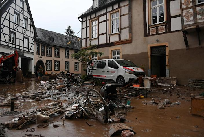 Image: A damaged car and bicycles are pictured in a muddy street in Ahrweiler-Bad Neuenahr, western Germany, (Christof Stache / AFP - Getty Images)