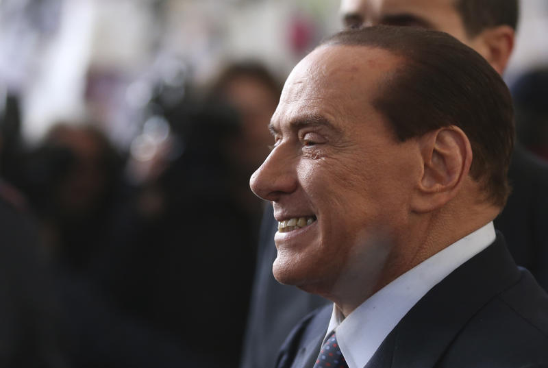 FILE - In this file photo taken Dec. 29, 2012 Silvio Berlusconi smiles as he arrives at Milan's central train station, Italy. Italy's top court confirmed Thursday, Aug. 1, 2013 Berlusconi tax fraud conviction, and ordered the review of a political ban contained in the sentence that was appealed by the Italian media Mogul. (AP Photo/Luca Bruno, file)