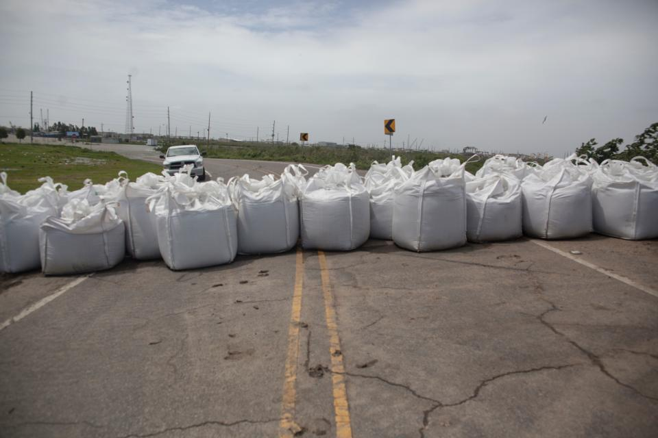 Blockcades full of sand block a road ahead of the arrival of Tropical Storm Barry on July 12, 2019 in Venice, Louisiana. - Tropical Storm Barry gathered strength as it chugged toward water-logged New Orleans, which girded for heavy rains, storm surge and flooding that pose a threat reminiscent of 2005's deadly Hurricane Katrina. The weather system, which has already caused major flooding in the low-lying city, is expected to reach hurricane strength Friday or early Saturday when it nears Louisiana's coast, according to the National Hurricane Center (NHC). (Photo by Seth HERALD / AFP)        (Photo credit should read SETH HERALD/AFP/Getty Images)