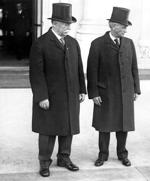 FILE - In this March 13, 1929, file photo former President and U.S. Supreme Court Chief Justice William Howard Taft left, and Justice Louis Brandeis, leave the White House in Washington after paying their first call on President Herbert Hoover. Way before Weight Watchers, Taft, the nation's 27th president, helped usher in a modern approach to treating obesity according to a report released Monday, Oct. 14, 2013, in the journal Annals of Internal Medicine. Weighing in at 314 pounds in 1905, four years before becoming president, Taft hired British dieting expert Nathaniel Yorke-Davies. Taft was worried about his health, about heartburn, sleep apnea, and other health problems. The doctor mailed him three-page list of allowed and forbidden foods, and Taft was to weigh himself daily and mail a weekly report. And Yorke-Davies nagged, politely, but a lot. (AP Photo/File)
