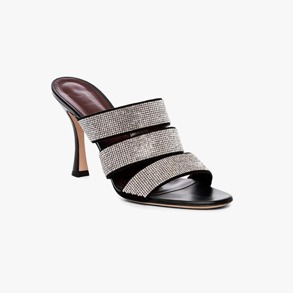 """$395, STAUD. <a href=""""https://staud.clothing/collections/heels-1/products/sonny-rhinestone-sandal-black?variant=40595232686253"""" rel=""""nofollow noopener"""" target=""""_blank"""" data-ylk=""""slk:Get it now!"""" class=""""link rapid-noclick-resp"""">Get it now!</a>"""