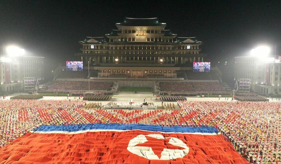 North Korean soldiers unfold the country's flag during a military parade at Pyongyang's Kim Il-sung Square to celebrate the 73rd anniversary of the country's founding on September 9. Photo: KCNA/dpa