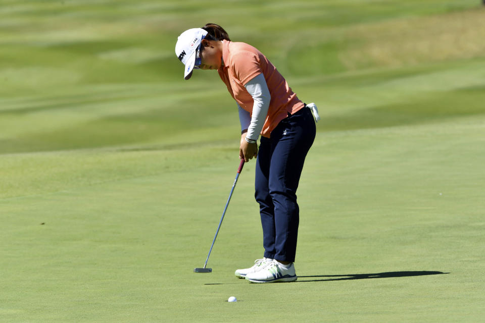 Nasa Hataoka, of Japan, sinks her putt on the 8th green during the second round of the LPGA Walmart NW Arkansas Championship golf tournament, Saturday, Sept. 25, 2021, in Rogers, Ark. (AP Photo/Michael Woods)
