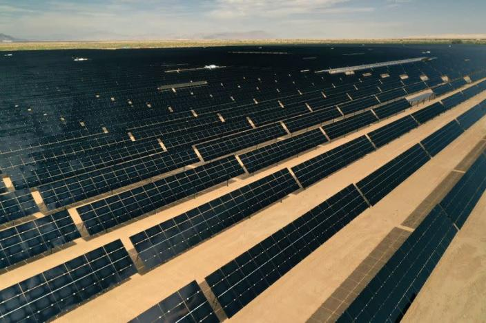 FILE PHOTO: Arrays of photovoltaic solar panels are seen at the Tenaska Imperial Solar Energy Center South as the spread of the coronavirus disease (COVID-19) continues in this aerial photo taken over El Centro, California