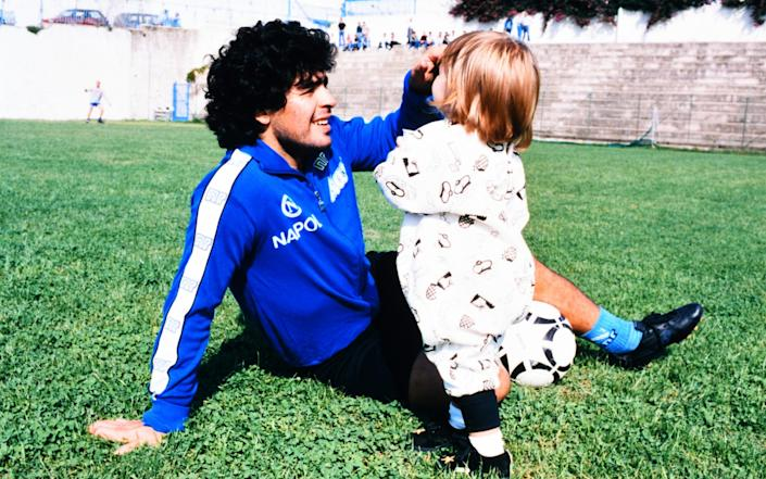 Diego Maradona of Napoli plays with his daughter Dalma after a training at the Centro Paradiso di Soccavo