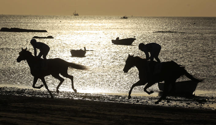 Jockeys take part in a race along the beach during low tide in the southern Spanish town of San Lucar de Barrameda, August 10, 2011. (Photo: REUTERS/Javier Diaz)
