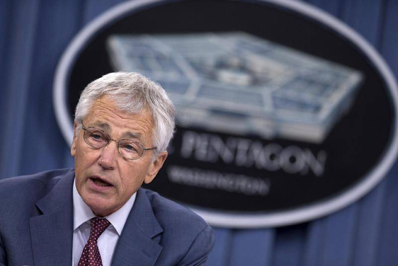 """FILE - In this July 31, 2013 file photo, U.S. Defense Secretary Chuck Hagel speaks at a Pentagon news conference in Washington. Hagel will meet for the first time with China's Minister of National Defense Gen. Chang Wanquan at the Pentagon on Monday, Aug. 19. Hagel is presiding over a Pentagon making a deliberate """"pivot"""" to Asia after more than a decade of wars in the greater Middle East, and improving ties with China is at the heart of the Obama administration's Asia strategy. (AP Photo/Evan Vucci, File)"""