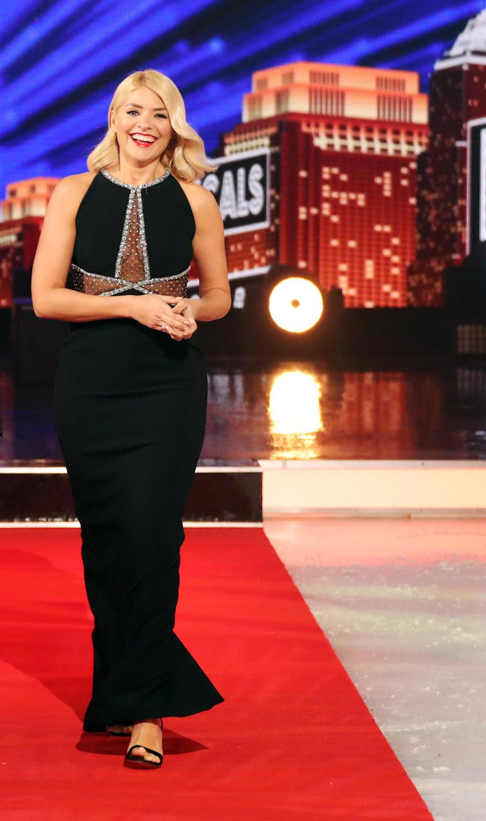 <p>For episode three of Dancing on Ice, the television presenter chose a glitzy Jenny Packham dress finished with Gina shoes. <em>[Photo: Rex]</em> </p>