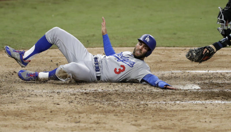 Los Angeles Dodgers' Chris Taylor scores on a double by Yasmani Grandal during the eighth inning of a baseball game against the San Diego Padres on Wednesday, April 18, 2018, in San Diego. (AP Photo/Gregory Bull)
