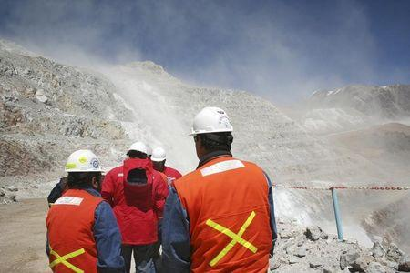 Workers walk near Barrick Gold Corp's Veladero gold mine between Chile's Huasco province and Argentina's San Juan province