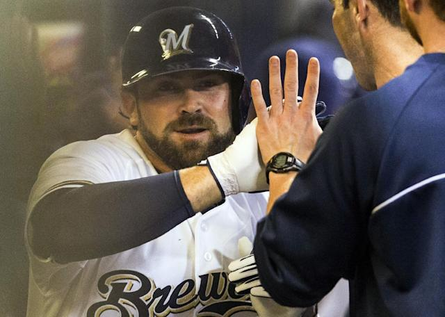 Milwaukee Brewers' Sean Halton, left, is greeted in the dugout by teammates after hitting a grand slam during the first inning of a baseball game against the Chicago Cubs, Wednesday, Sept. 18, 2013, in Milwaukee. (AP Photo/Tom Lynn)