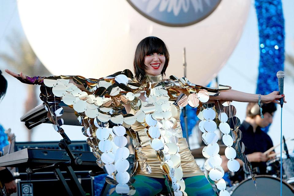 <p>Wearing a shimmering outfit while performing at Coachella in 2009.</p>