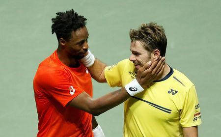 Tennis - ATP 500 - Rotterdam Open - Rotterdam Ahoy, Rotterdam, Netherlands - February 17, 2019 France's Gael Monfils and Switzerland's Stan Wawrinka after their Final match REUTERS/Eva Plevier