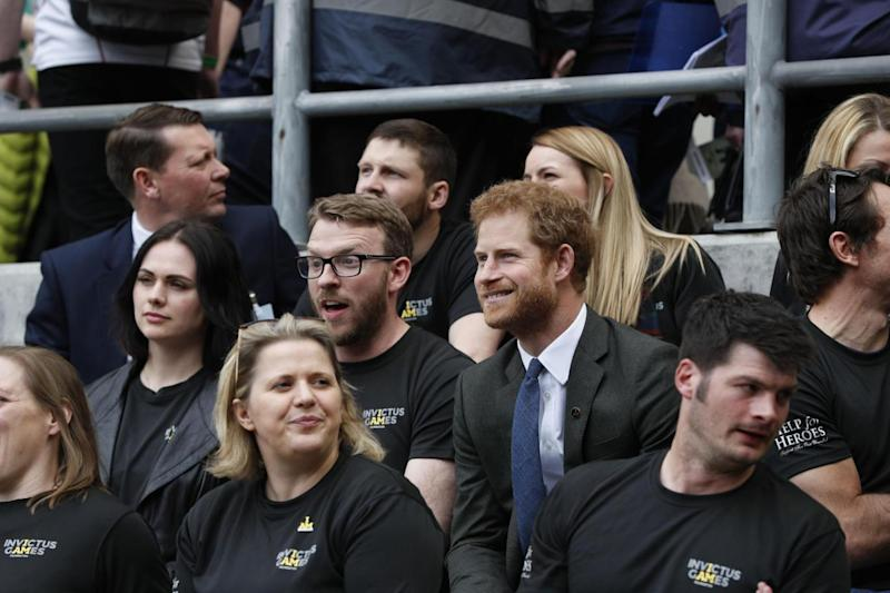 Prince Harry sits with competitors from the 2014 and 2016 Invictus Games (PA)