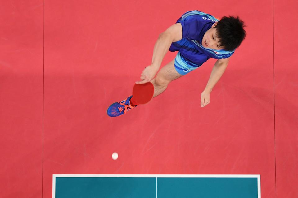<p>An overview image shows Japan's Tomokazu Harimoto smash to South Korea's Jang Woo-jin during the men's team table tennis match for the bronze medal between South Korea and Japan at the Tokyo Metropolitan Gymnasium during the Tokyo 2020 Olympic Games in Tokyo on August 6, 2021. (Photo by Jung Yeon-je / POOL / AFP)</p>
