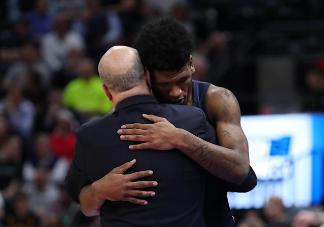 <p>Head coach Greg Herenda of the Fairleigh Dickinson Knights embraces Mike Holloway Jr. #34 after their 49-87 loss to the Gonzaga Bulldogs in the first round of the 2019 NCAA Men's Basketball Tournament at Vivint Smart Home Arena on March 21, 2019 in Salt Lake City, Utah. (Tom Pennington/Getty Images) </p>