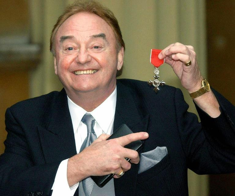 Gerry Marsden receiving his MBE medal at Buckingham Palace in 2003, for services to Liverpool charities