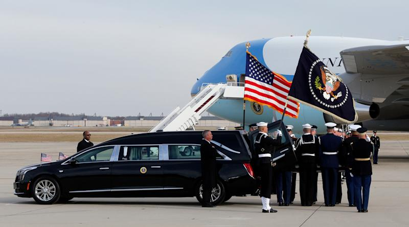 The flag-draped casket of former President George H.W. Bush is carried by a joint services military honor guard during a departure ceremony at Andrews Air Force Base in Maryland on Wednesday. (Photo: ASSOCIATED PRESS)