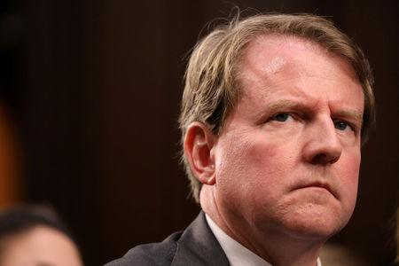 FILE PHOTO: White House Counsel McGahn listens during the confirmation hearing for U.S. Supreme Court nominee Kavanaugh on Capitol Hill in Washington