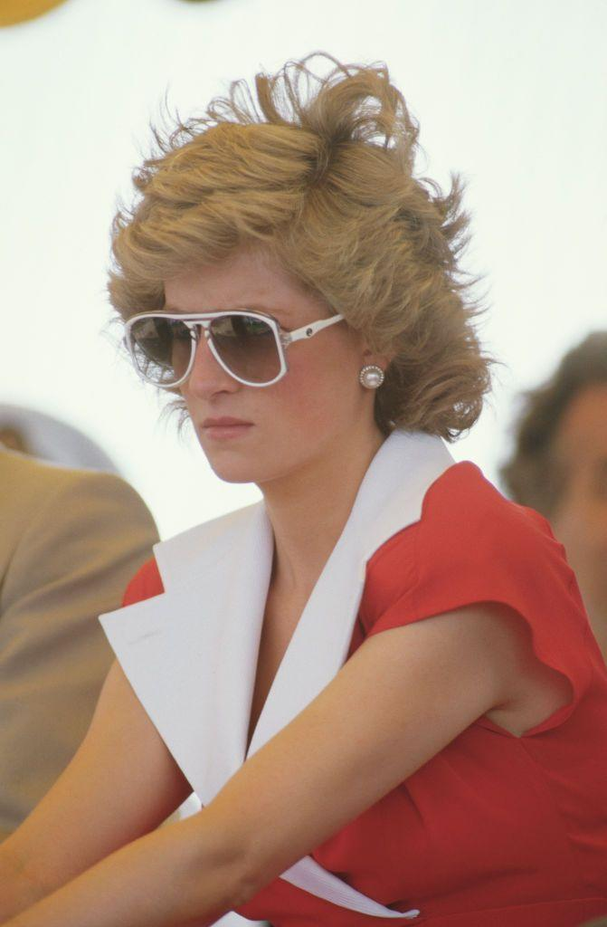 <p>Princess Diana made an official appearance in Australia in 1988 wearing a red dress with and exaggerated notch collar designed by Alistair Blair. </p>