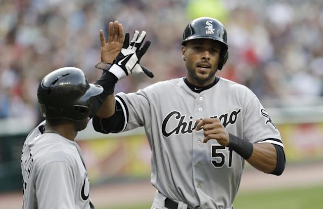 Chicago White Sox's Alejandro De Aza, left, congratulates Alex Rios after both scored on a hit by Adam Dunn in the first inning of a baseball game against the Cleveland Indians, Tuesday, July 30, 2013, in Cleveland. (AP Photo/Tony Dejak)